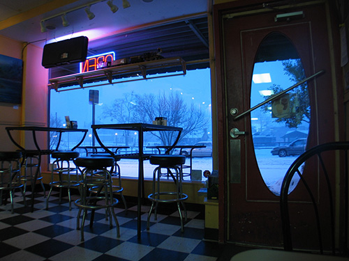 A snow storm in Sanford, NC as seen through the front window of the Java Express, 2009.