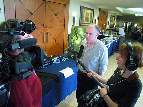 X-Conference organizer Stephen Bassett speaks to a film crew at the 2009 X-Conference.