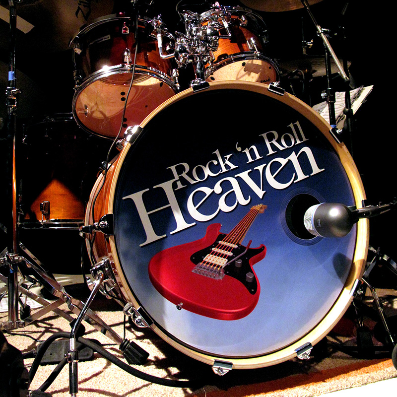 Rock 'n Roll Heaven drummer Garret McKinney suggested putting the show brand on his drum head. Nice.