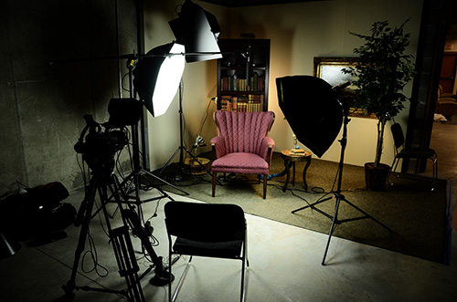 Our oral history project sound stage at the Upstate History Museum. Some famous and some not so famous faces illuminated.