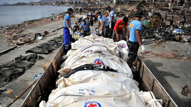 Body bags being loaded for delivery to a mass graves in Tacloban November 16, less than a week before our national attention turned to something that happened to us a half century ago.